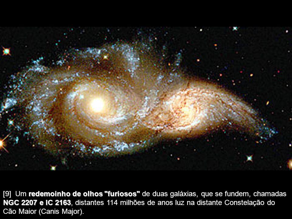 [9] Um redemoinho de olhos furiosos de duas galáxias, que se fundem, chamadas NGC 2207 e IC 2163, distantes 114 milhões de anos luz na distante Constelação do Cão Maior (Canis Major).